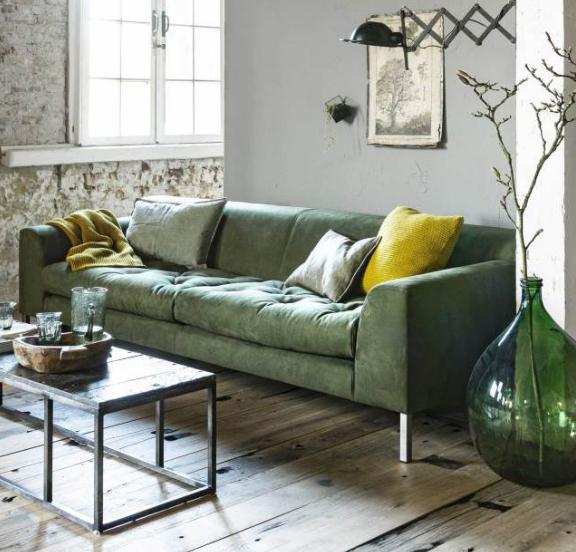 Cómo combinar un sofá verde