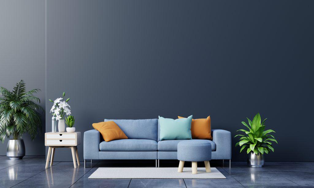 sofá-azul-cojines-naranjas